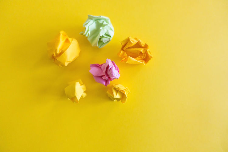 Crumpled Background Close-up Colored Background Crumpled Crumpled Paper Day Flower Flower Head Fragility Freshness Nature No People Outdoors Paper Petal Stationary Studio Shot White Background Yellow Yellow Background Yellow Color