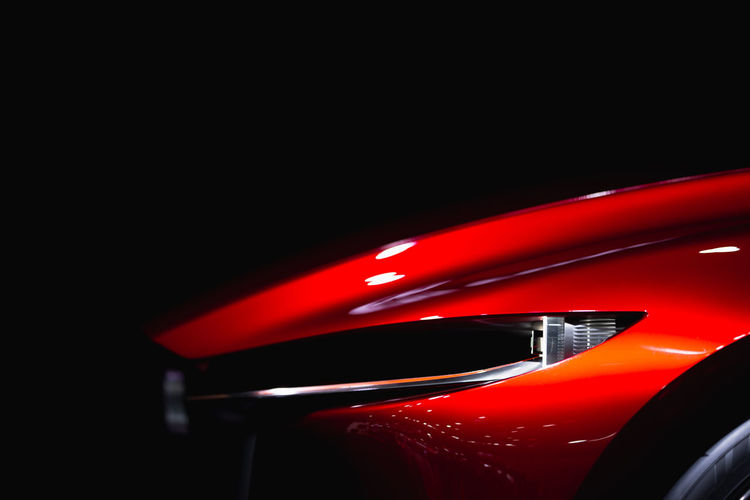 Red Mode Of Transportation Car Transportation Motor Vehicle Land Vehicle No People Tail Light Copy Space Indoors  Close-up Lighting Equipment Reflection Vehicle Interior Shiny Glass - Material Vehicle Part Retro Styled Travel Wheel Luxury Headlight New Front Light Transportation
