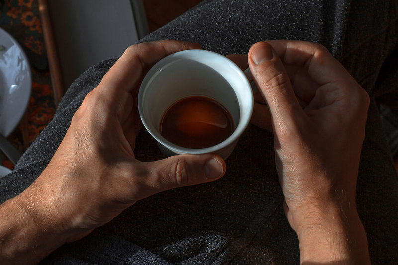 warmth Coffee Morning Morning Light Morning Coffee Black Coffee Close-up Coffee - Drink Coffee Cup Cup Drink Food And Drink Holding Human Body Part Morning Rituals Real People Refreshment Tea - Hot Drink