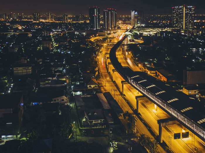 Metro station in the middle of the city at night.High angle view.Focus at the BTS station. Architecture Building Exterior Built Structure City Cityscape Illuminated Modern Night No People Outdoors Sky