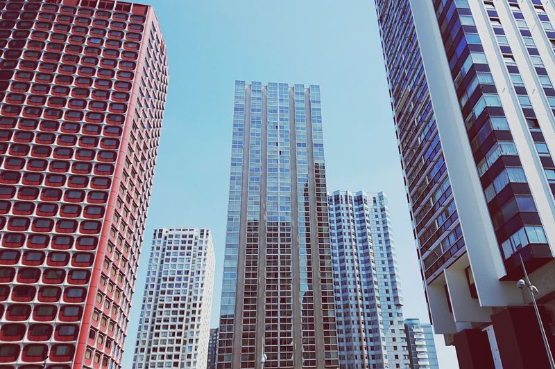 Low angle view of modern buildings against clear sky