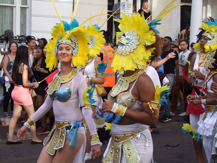 Dancers, Nottinghill Carnival Official 50th Anniversary Carnival Composition Costumes Creativity Feathers Front View Full Frame GB Happy Incidental People London Looking At Camera Multi Coloured Multiculturalism Nottinghill Carnival Outdoor Photography Performer  Smiling Stage Costume Three Quarter Length Togetherness Tourist Attraction  Two Dancers Two Women
