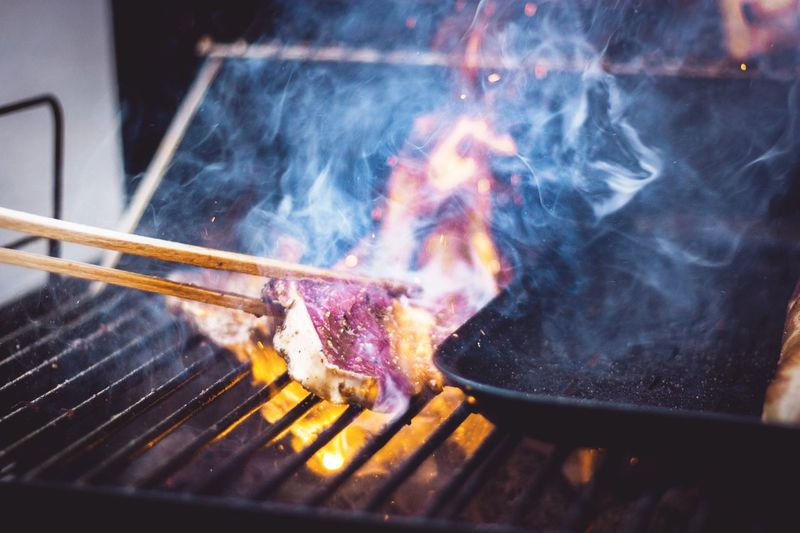 Close-up of beef cooking on barbecue grill