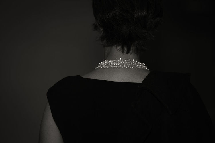 Rear view of woman wearing necklace