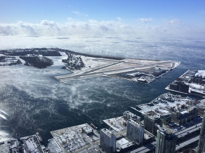 Aerial view of billy bishop toronto city airport against sky