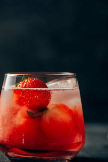 Close-up of strawberry in glass
