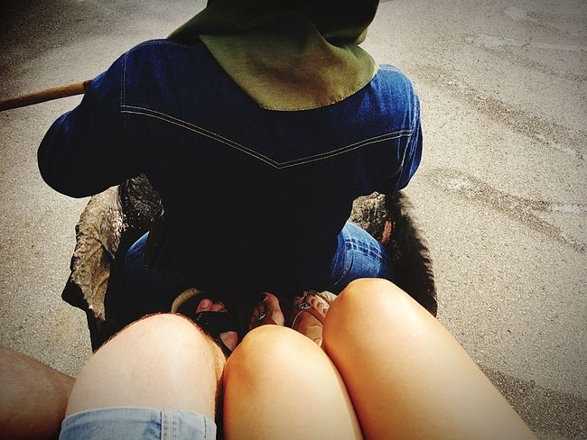 EyeEm Selects Human Leg Real People Sitting Low Section Leisure Activity Casual Clothing Lifestyles Men Human Body Part Women Day Adult Midsection Bonding People Outdoors Adults Only