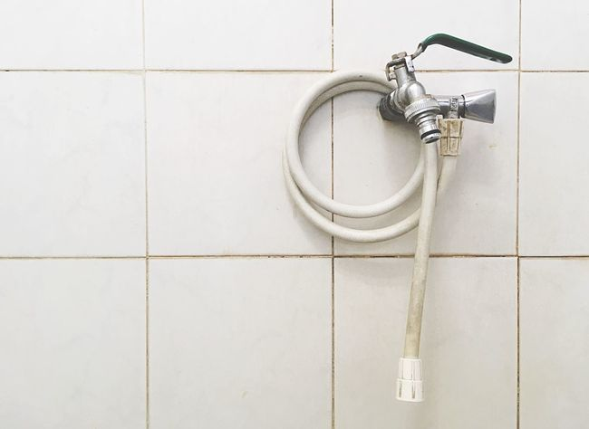 Water Tap Hosepipe Pipe Watertap Tile Wall - Building Feature Flooring No People Built Structure Bathroom Indoors  White Color Domestic Bathroom Close-up Home Shape Tiled Floor