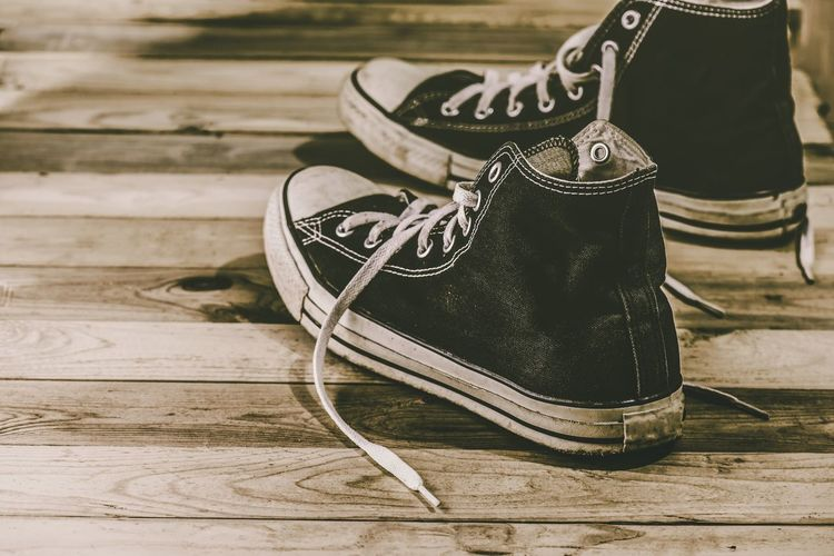 Sneakers Blackandwhite Men Converse Sneakers Still Life No People Shoe Table Close-up Focus On Foreground Wood - Material Fashion Pattern High Angle View Flooring Day Wood Personal Accessory Indoors