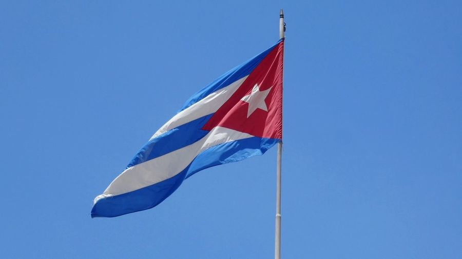 cuban flag against blue sky Cuba Collection Cuban Flag Cuba Collection Blue Sky EyeEm Gallery Flag In The Wind Clear Sky Blue Patriotism Flag Wind Sky National Icon Symbolism Flag Pole Fluttering National Flag Identity
