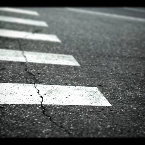 Close-up of zebra crossing on road