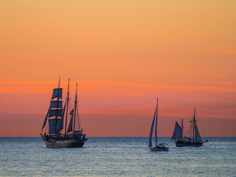 Windjammer on the Baltic Sea in Warnemuende, Germany. Baltic Sea Coast Evening Hanse Sail Nautical Vessel No People Outdoors Rostock Sailing Sailing Ship Sea Shore Sky Sundown Sunset Tall Ship Warnemünde Windjammer