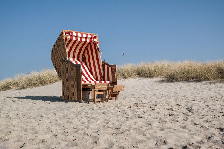 Chair On Beach Against Clear Sky