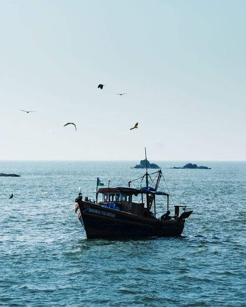 Horizons Fishermen Nautical Vessel Boat Fishing Fisherman Blue Silhouette Beauty Shadows Kerala India In The Distance Tranquility Ocean FarOff Destination Alone Sea Clear Sky UnderSea People Beauty In Nature Water Flying Beach Day Blue Fisherman Sky