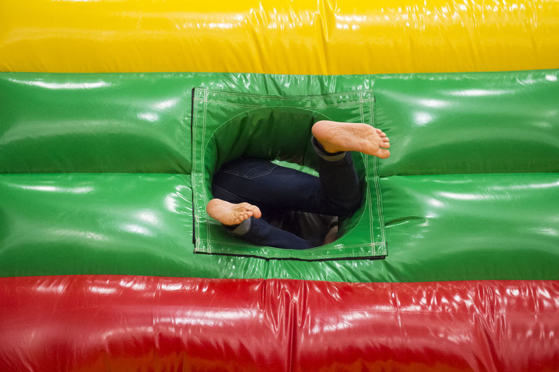 Low section of child in bouncy castle
