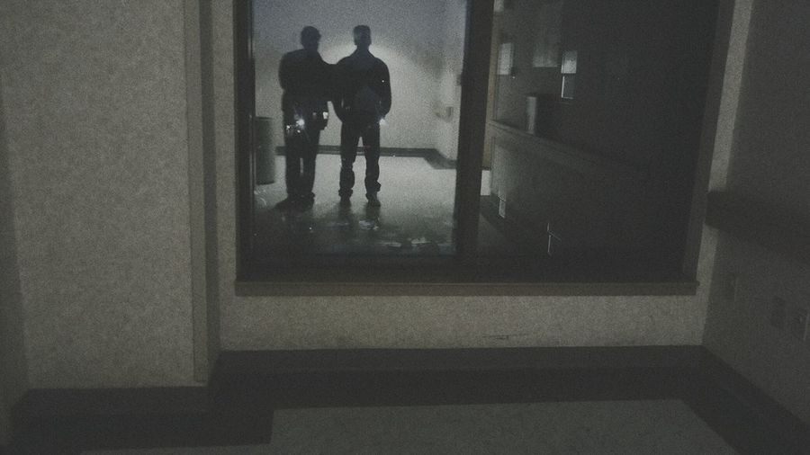 Silhouette of man standing in corridor