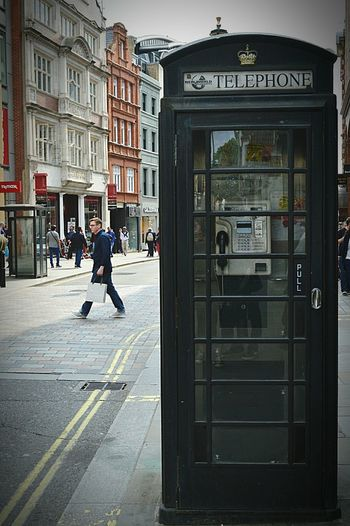 Also in black Telephone Box Black Box Telephone LONDON❤ My City London London Streets London Life People Watching United Kingdom Nikon D3200 The Street Photographer - 2016 EyeEm Awards