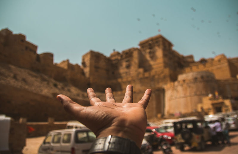 Fort of Jaisalmer ... Travel Destinations Travel Exploring Selective Focus Bokeh Rajasthan Streetphotography Jaisalmer Fort Cultures Tradition Sand Desert Vehicle Sky Human Hand Palm Pleading Gesturing Human Finger Sky Architecture Hand Raised Visiting Tourist Attraction  Famous Place Tourism The Traveler - 2019 EyeEm Awards