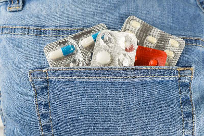 Close-up of medicines in back pocket of jeans