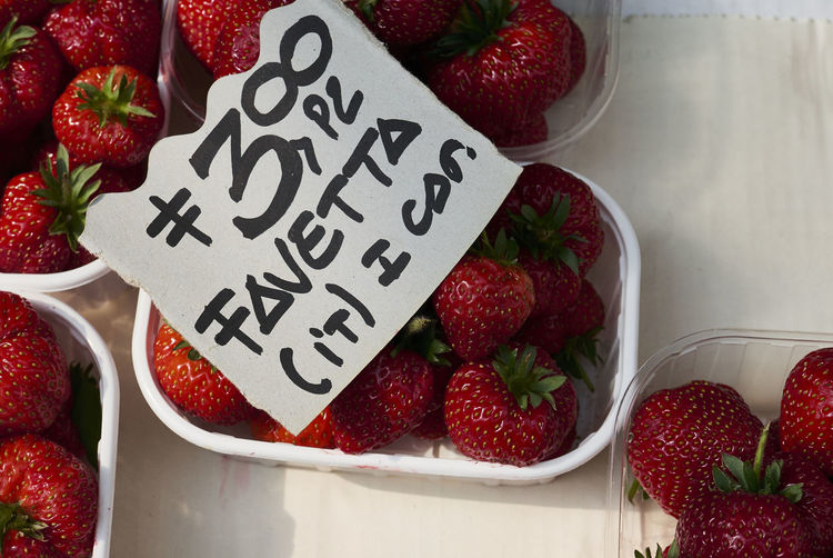 Close-up of strawberries with price tag for sale