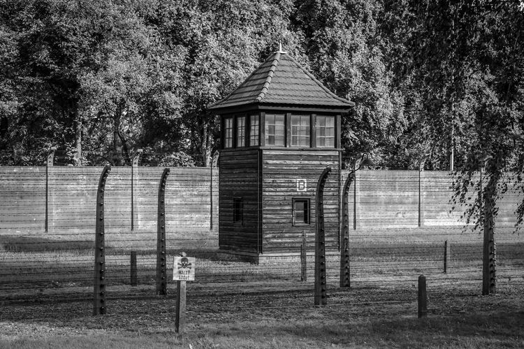 Auschwitz Auschwitz Birkenau Auschwitz  Architecture Built Structure Building Exterior Tree Plant No People Day Security Safety Building Protection Outdoors Fence Nature House Boundary Closed Entrance Barrier Land