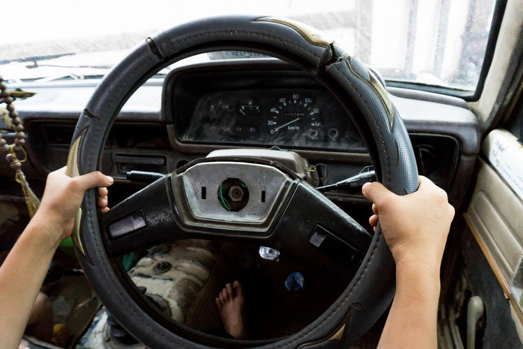 Car Car Interior Close-up Dashboard Day Holding Human Body Part Human Hand Land Vehicle Men Mode Of Transport Old Old Driver One Person Outdoors People Real People Speedometer Steering Wheel Transportation Vehicle Interior