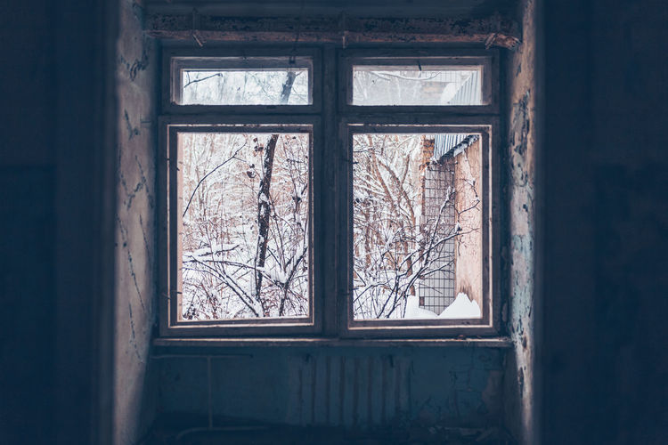 Damaged window of abandoned building in chernobyl zone at pripyat