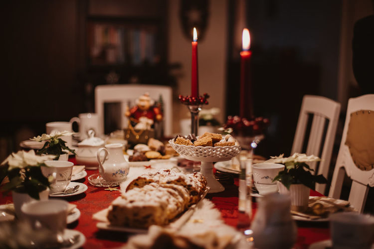 cookies and stollen on a festive table ready laid on Christmas eve Food And Drink Food Candle Table Indoors  Freshness Sweet Food Plate Sweet Baked Cake No People Selective Focus Indulgence Dessert Burning Celebration Fire Ready-to-eat Still Life Temptation Crockery Glass Setting Luxury