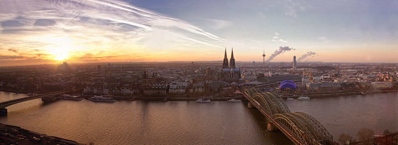 Architecture Built Structure Capital Cities  City City Life Cityscape Cloud Cloud - Sky Cologne Germany Köln Nature No People Orange Color Outdoors Residential District River Riverside Sky Sun Sunbeam Sunset Tourism Travel Destinations Water