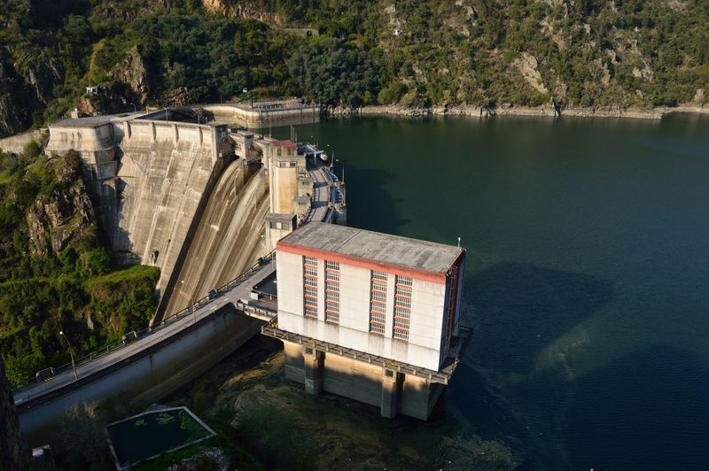 Architecture Beauty In Nature Built Structure Dam Day Fuel And Power Generation High Angle View Hydroelectric Power Mode Of Transportation Nature Nautical Vessel No People Outdoors Plant River Transportation Travel Tree Water