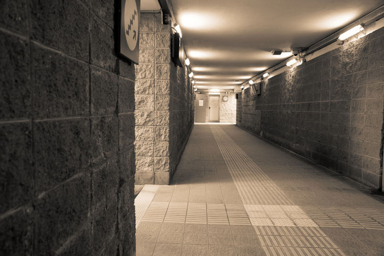 Illuminated Architecture Lighting Equipment Wall - Building Feature The Way Forward Direction Built Structure Flooring Indoors  No People Tile Building Corridor Footpath Arcade Empty Diminishing Perspective Subway Absence Wall Ceiling Tiled Floor Light Underground Walkway Underpass