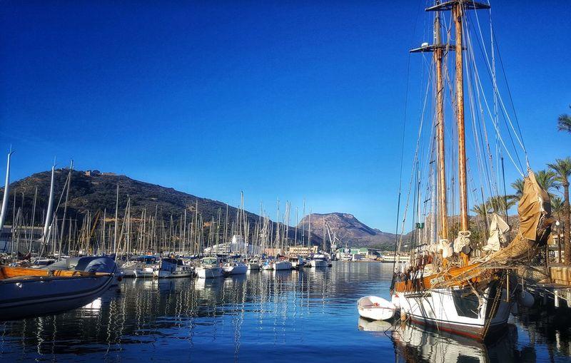 Clear Sky Mountain Harbor Moored Blue Mast Sea Sky Marina Sailboat Bay Dock Sailing Boat Water Vehicle Sailing Port