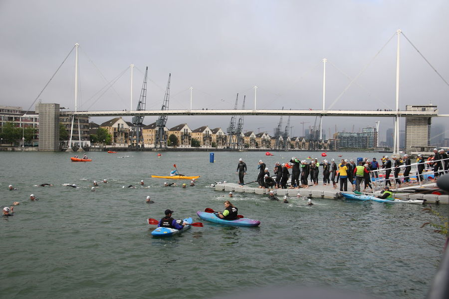 TRIATHLON Adults Only Architecture Bridge - Man Made Structure Building Exterior Canoes Day Docklands Exercising Kayaks Large Group Of People Leisure Activity Outdoors People Pontoon Sky Sport Swimmers Triathletes Water Wetsuits