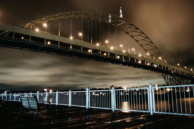 Illuminated bridge over river