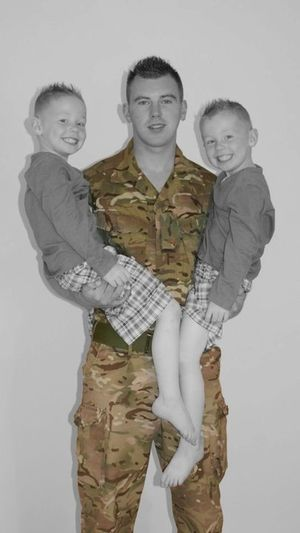 Transitional Moments dad leaving his kids for the first time to go to war. Family Captured Moment Photography