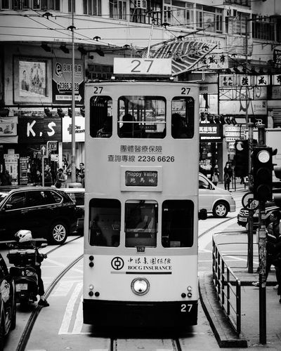 The tram ride. Double Decker tram at Wan Chai district. Hong Kong. Travel Destinations Cityscape City City Life Public Transportation Transportation Mode Of Transport Tram Stop Day Photooftheday Photography Blackandwhite Blackandwhite Photography Text Refueling Gasoline Indoors  Fuel Pump No People