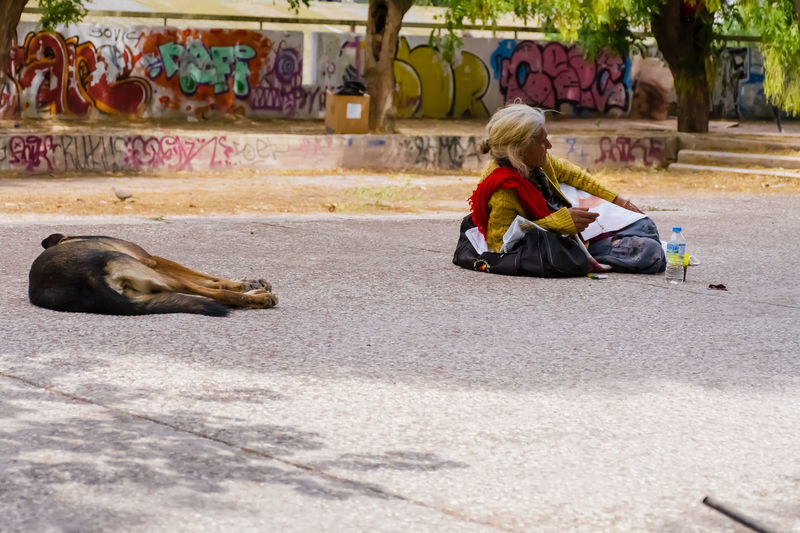 beggar woman.. Adult Adults Only Animal Themes Beggar Beggar Woman Crouching Day Full Length Mammal One Person Outdoors People Real People Sitting The Photojournalist - 2017 EyeEm Awards Young Adult BYOPaper!