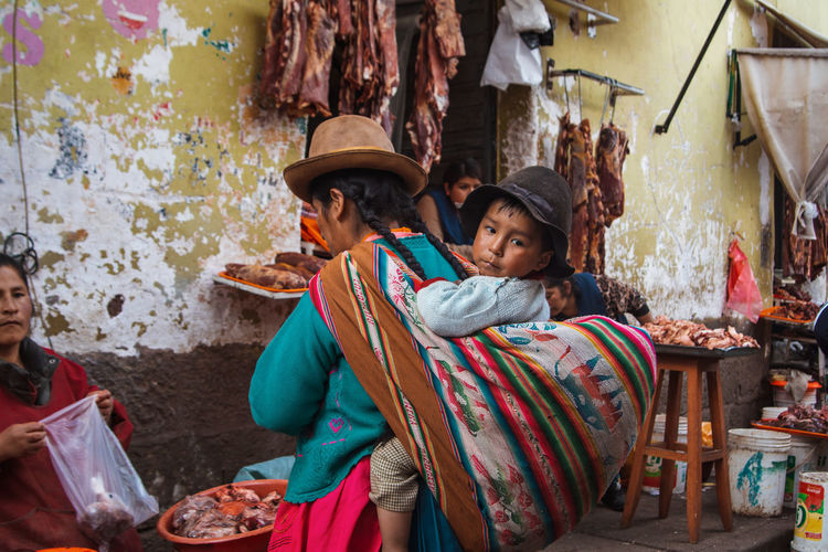 Exploring the street market just south of the San Pedro Market. Andes Backpacking City Cityscape Exploring Inca Latin America Adult Child Childhood Clothing Colonial Day Discover  Lifestyles Market People Real People Sitting South America Togetherness Traditional Clothing Travel Destinations Two People Women The Traveler - 2018 EyeEm Awards The Portraitist - 2018 EyeEm Awards The Street Photographer - 2018 EyeEm Awards
