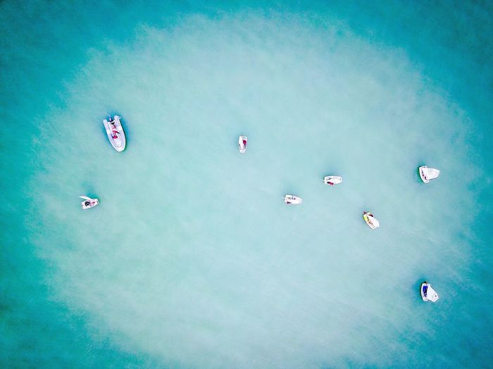 Aerial view of boats in blue sea