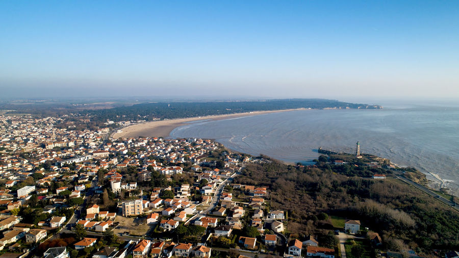 Aerial view of Saint Georges de Didonne at sunset in Charente Maritime, France Saint Georges De Didonne Charente-Maritime France City Valliere Lighthouse Suzac Sunset Water Sea Beach Port Bay Harbor Atlantic Ocean Coastline Coast Aerial View Aerial Photography Landscape Seascape Cityscape Travel Destinations Dji Phantom 4 Pro