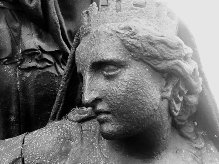 Close-up portrait of statue by water