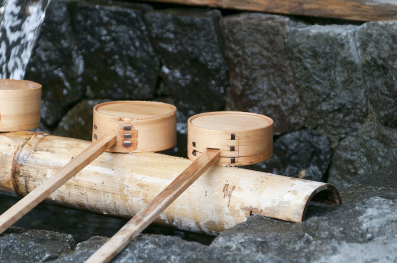 Close-up of bamboo ladles on rock