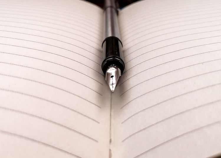 High angle view of pen on book