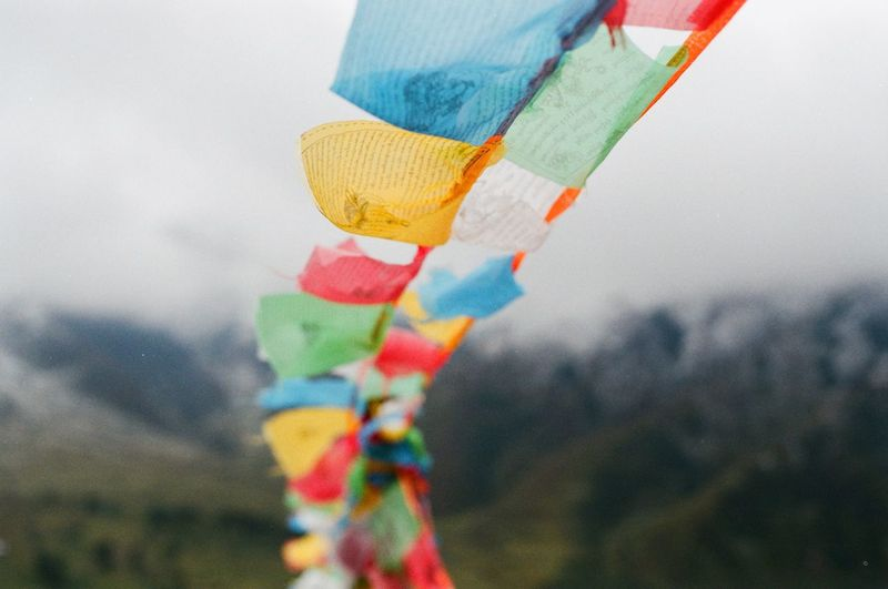 Tibetan  Tibet Multi Colored Focus On Foreground Close-up No People Day Art And Craft Outdoors Nature Textile Decoration Creativity Ribbon Cloud - Sky Hanging Sky Still Life Craft Celebration Emotion