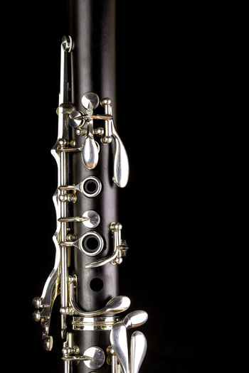 Music Instrument Clarinet, Clarinet Isolated on black Musical Instrument Studio Shot Music Black Background Arts Culture And Entertainment Close-up Indoors  Metal Wind Instrument Single Object Copy Space Cut Out No People Shiny Jazz Music Gold Colored Brass Still Life Brass Instrument  Musical Equipment Silver Colored Stage