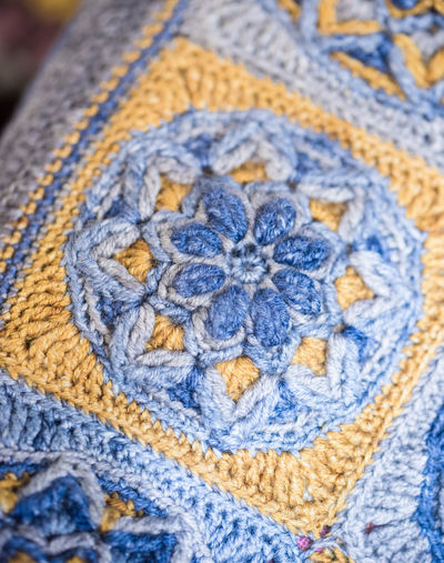 Textile Close-up Blue Full Frame No People Pattern Wool Art And Craft Creativity Craft Backgrounds Textured  Still Life Indoors  Day High Angle View White Color Focus On Foreground Multi Colored Floral Pattern Warm Clothing Jeans Embroidery