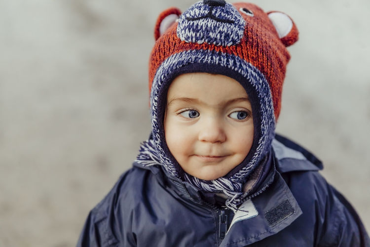 Cute girl in warm clothing looking away