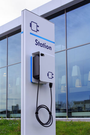 Charging station for electic vehicles E-motion Elektromobilität Ladestation Stromtankstelle Automotive Charger Charging Electric Car Charging Station Chargingstation Close-up E-mobility E-mobilität E-station Energiewende Ladestation Outdoors Transportation