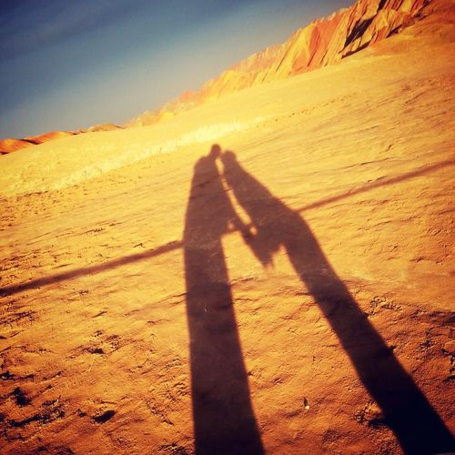 Desert 43 Golden Moments Couple On The Way Fine Art Photography Kiss Shadow Zhangye  Danxia Landform Qinghai China Sunset Sunshine Sunset_collection Best EyeEm Shot
