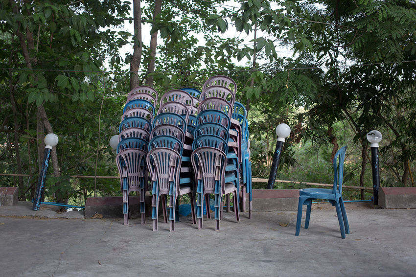Pile of chairs found near Utopia Tower, Yangon, Myanmar ASIA Burma Chair Construction Documentary Photography Found Art Myanmar Nature In The City No People Outdoors Pile Pile Of Chairs Rangoon Ready Made South East Asia Street Photography Street Scene Streetphoto Streetphotography Structure Summer Tree Utopia Utopia Tower Yangon